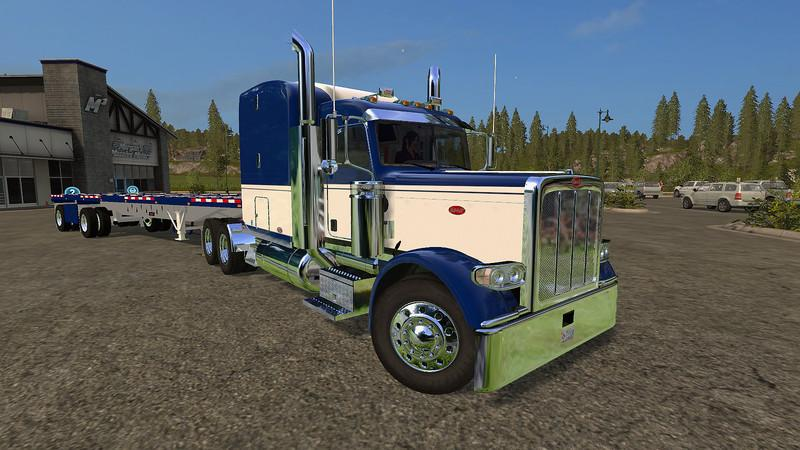 1481167210 peterbilt 388 and manic flatbed trailer
